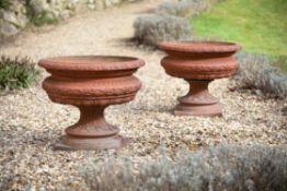 A pair of Victorian terracotta garden urns