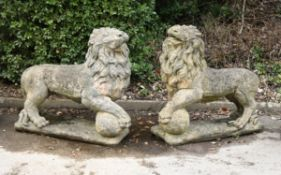A pair of large stone composition models of lions
