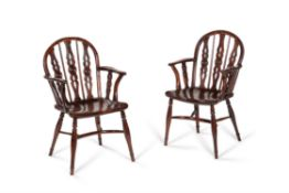 A matched pair of yew and elm Windsor armchairs