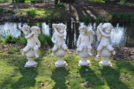 A set of four sculpted white marble models of putti