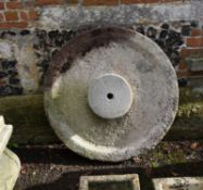 A carved millstone