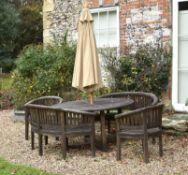 A suite of teak garden furniture by Cotswold Teak