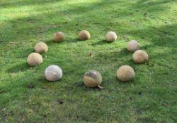 A set of ten stone garden spheres