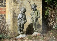 A pair of lead garden models of putti