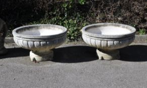 A pair of composition tazza urns