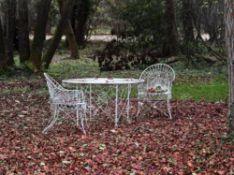 A suite of Victorian white painted wirework garden furniture