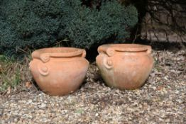 A pair of terracotta jardinieres in the style of examples by the Compton Pottery