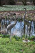 A pair of Japanese patinated metal models of storks