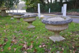 Four stone composition tazza urns
