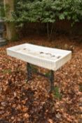 A glazed stoneware and cast iron garden sink or trough