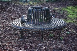 A patinated metal park or tree seat