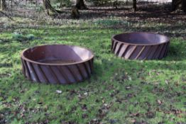 A pair of substantial cast iron and sheet metal lined circular planters