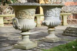 A pair of stone composition campana urns