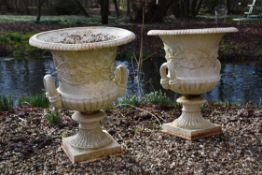 A pair of Victorian white painted cast iron campana urns