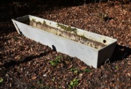 A white painted iron trough