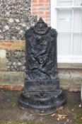 A painted cast iron wall fountain to a model by Val d'Osne