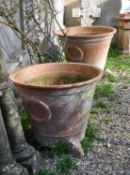 A pair of French oversized terracotta jardinieres