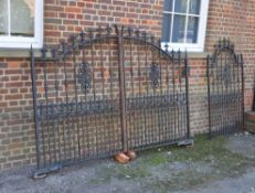 A set of black painted cast and wrought iron gates