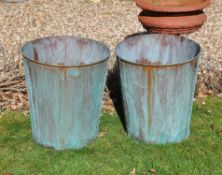 A pair of verdigris copper buckets or planters