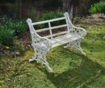 A Victorian cream painted cast iron garden bench
