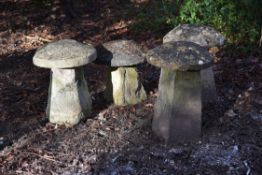 A group of four carved staddle stones