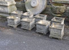 A set of eight stone composition planters in Neoclassical style
