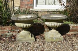 A pair of small stone composition planters