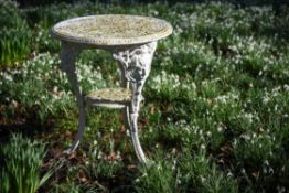 A white painted cast iron garden table