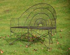A black painted wirework garden bench