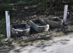 Three various stone troughs or basins