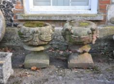 A pair of English red stoneware pier finials