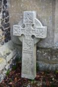 A sculpted white marble cross