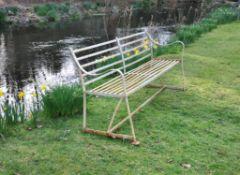An English white painted wrought iron garden bench