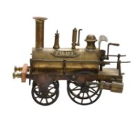 A period model of polished brass 'Piddler' 2-2-0 steam locomotive
