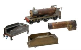 A part built model of a 2 1/2 inch gauge 4-4-0 tender locomotive