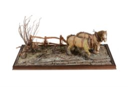 A fine large diorama of a pair of heavy horses with leather working set of harness
