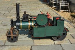 A freelance approximate 3 inch scale model of a live steam road roller