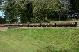 A rake of six 5 inch gauge Great Western Railway bogie coaches