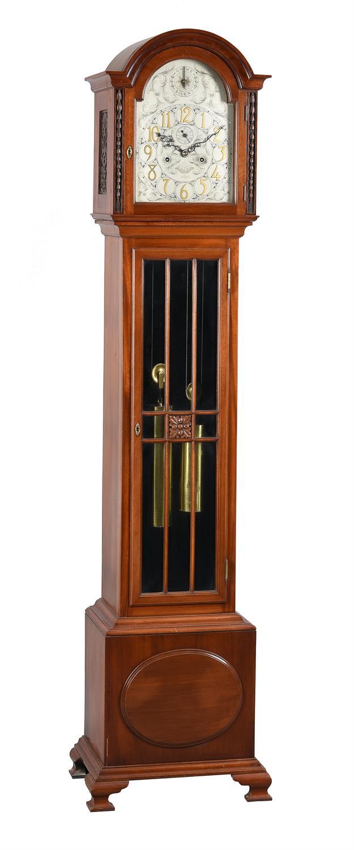 A mahogany eight-day quarter-chiming longcase clock