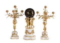 A French Louis XVI style ormolu and white marble mantel clock garniture