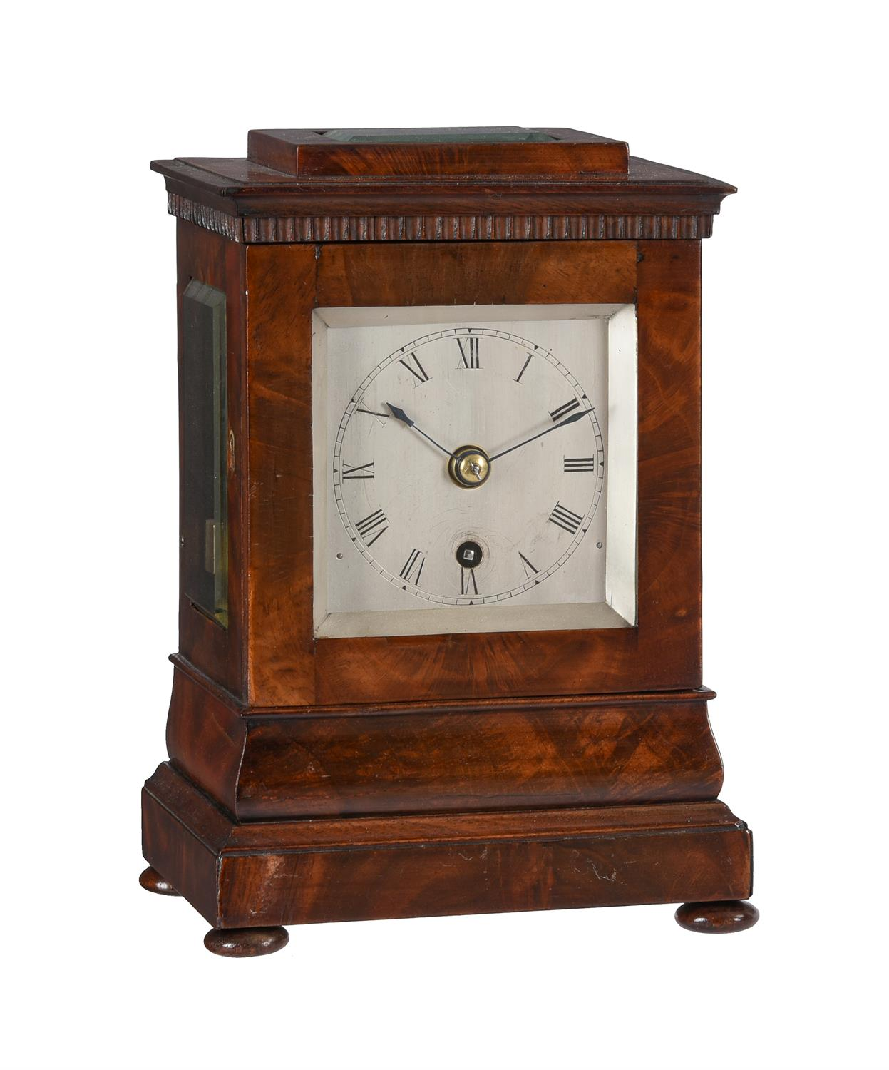 A Victorian figured mahogany small four-glass library mantel timepiece