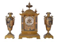 A French brass mantel clock garniture with relief cast panels