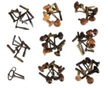 A collection of forty-three longcase clock crank keys