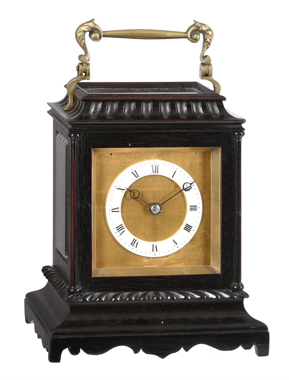 An ebonised carriage clock