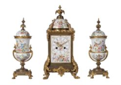 A French gilt brass and painted porcelain mantel clock garniture