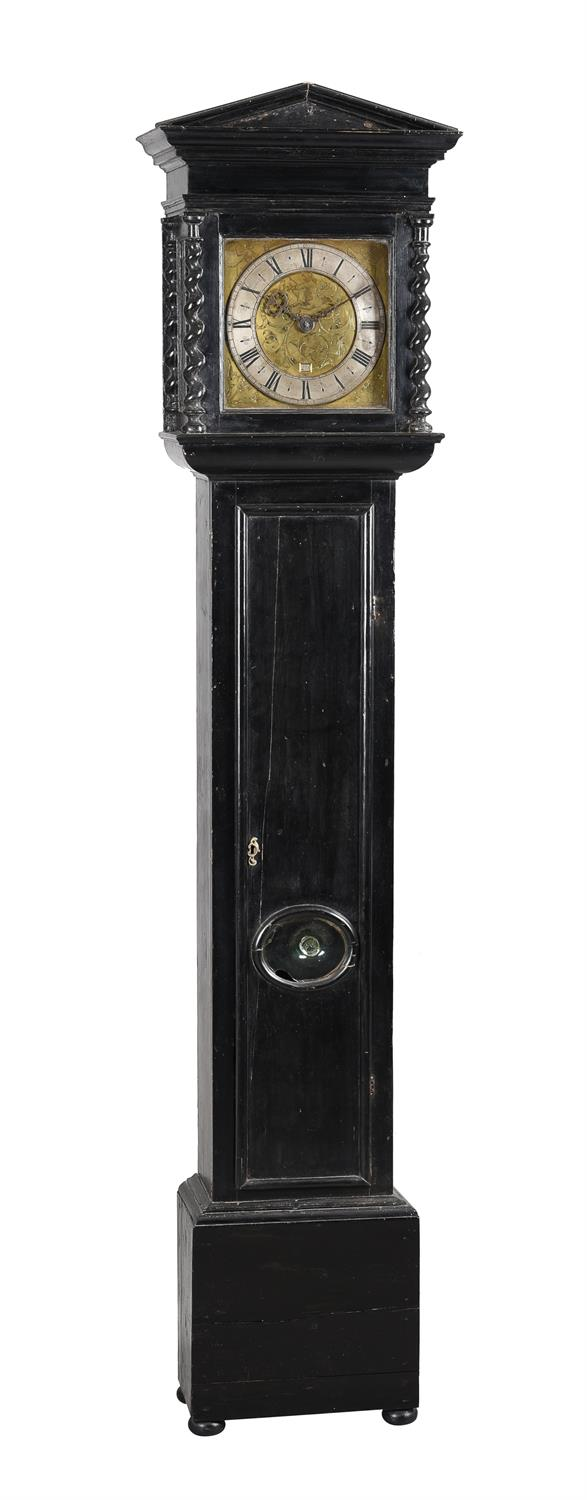 A fine Charles II ebonised thirty-hour longcase clock with unusual figural engraved 10 inch dial