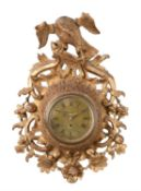 A George III giltwood cartel wall timepiece with seven inch dial