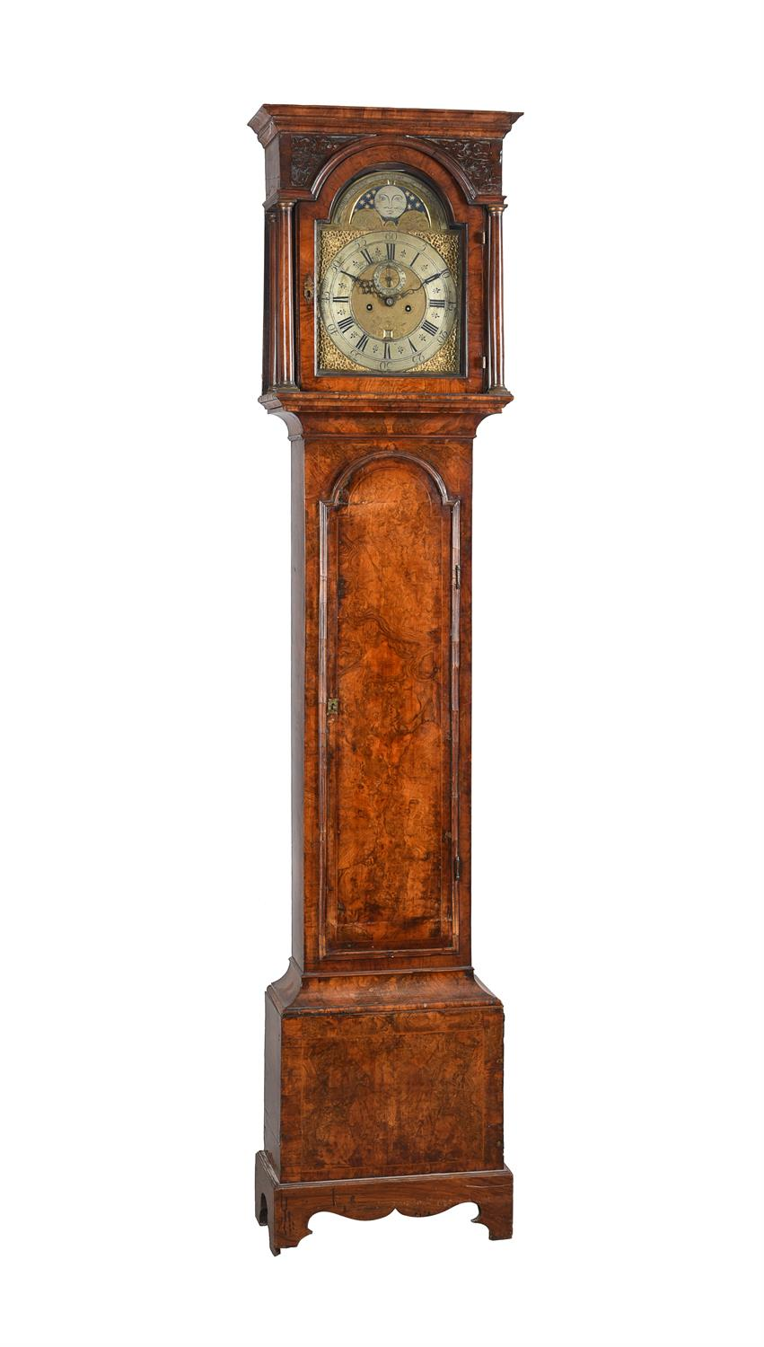 A figured walnut eight-day longcase clock with moonphase