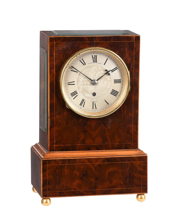 An inlaid mahogany mantel timepiece