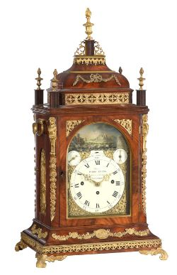 An impressive George III brass mounted musical quarter-chiming automaton table clock